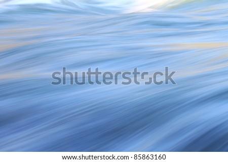 Vivid blue colors reflect off LeHardys Rapids of the Yellowstone River - stock photo