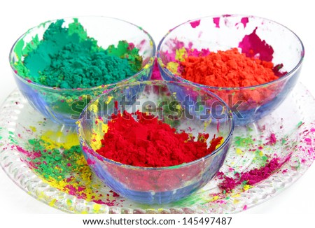 Vivid color gulal kept in a bowl focus on red - stock photo