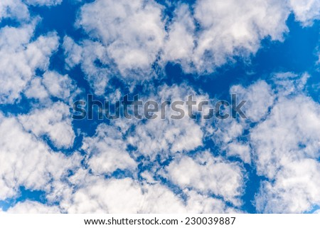 Vivid image of clouds looking straight up - stock photo