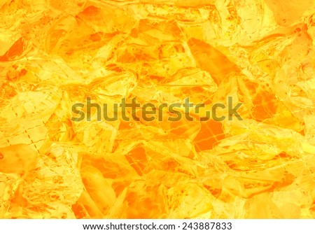 Vivid sunny warm ocher background of luminous crystalline translucent stones. Close up view with space for text - stock photo