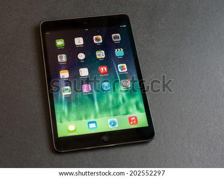 VLADIVOSTOK, RUSSIA - JUNE 4, 2014: Apple iPad mini displaying iOS 7 homescreen, russian version. iOS 7 operating system designed by Apple Inc.  - stock photo
