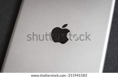 VLADIVOSTOK, RUSSIA - JUNE 4, 2014: Apple iPad mini on dark backround, backside. Apple iPad mini - tablet pc designed by Apple Inc.  - stock photo