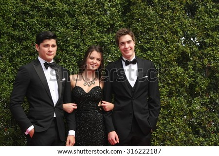 vLOS ANGELES - SEP 12:  Actors Ricardo Hoyos, Ana Golja, Eric Osborne at the Primetime Creative Emmy Awards Arrivals at the Microsoft Theater on September 12, 2015 in Los Angeles, CA - stock photo