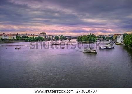 Vltava River in Prague, Czech Republic  in the evening - stock photo