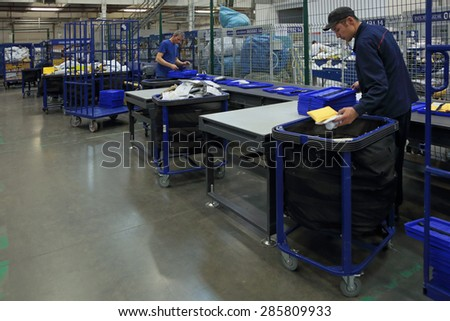VNUKOVO, MOSCOW REGION, RUSSIA - APR 7, 2015: Russian Post. Logistics center in Vnukovo, employees in the workplace - stock photo