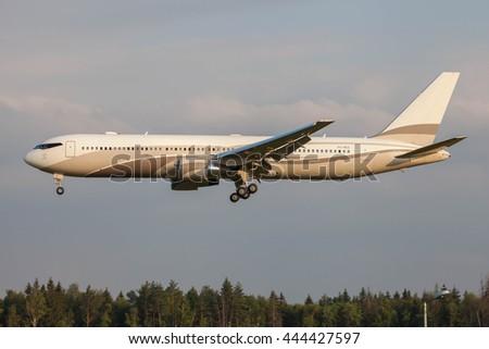 VNUKOVO, MOSCOW REGION, RUSSIA - JUNE 27, 2016: Airplanes at Vnukovo international airport. The plane of Roman Abramovich Boeing 767-300 landing at Vnukovo airport - stock photo