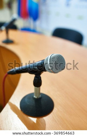 Vocal Dynamic Microphone on the table at Conference - stock photo