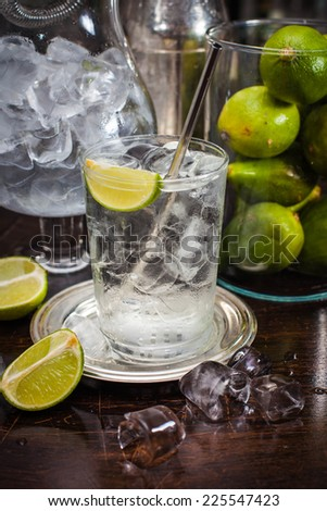 Vodka and tonic drink on  bar - stock photo