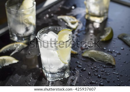 vodka. frozen alcoholic cocktail, refreshment drink with vodka and lime served at bar - stock photo