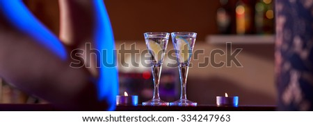 Vodka shots with lime on the bar - stock photo