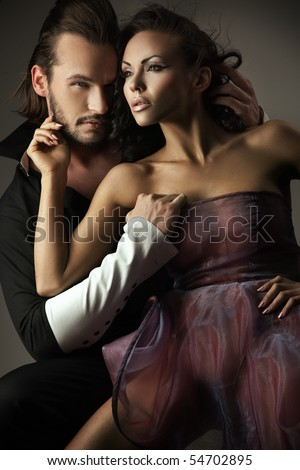 Vogue style photo of a cute couple - stock photo