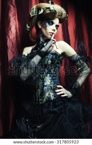 Vogue style photo of a gothic woman.Halloween theme.  - stock photo
