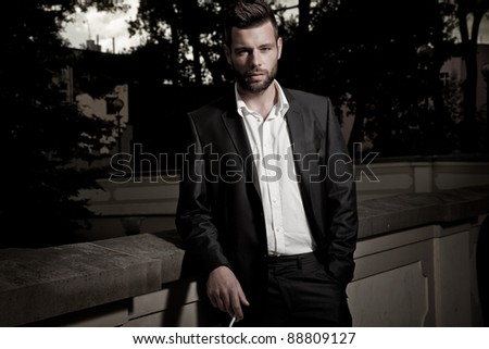 Vogue style photo of a handsome man - stock photo