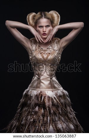 Vogue style photo of a young beauty woman isolated on black background - stock photo