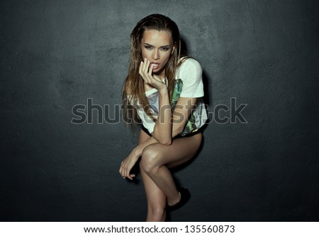 Vogue style photo of woman with smoky eyes - stock photo