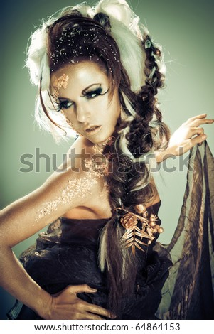 Vogue style portrait of a woman with gold-silver bodyart and makeup - stock photo