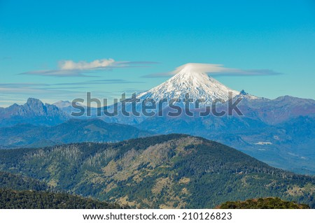 Volcan Villarrica viewed from Santuario El Cani, near Pucon, Chile. - stock photo