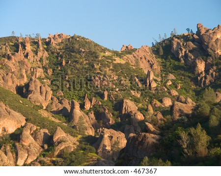 Volcanic boulders litter the side of the mountain on the western side of the Pinnacles National Monument in California. - stock photo