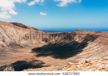 Volcanic landscape in Lanzarote island , Spain  - stock photo