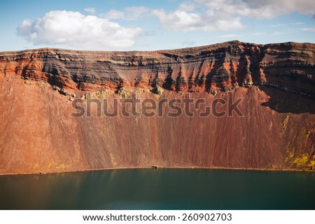 Volcanic landscape with crater lake. Iceland - stock photo