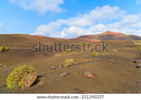Volcanic mountain landscape in Timanfaya National Park, Lanzarote, Canary Islands, Spain - stock photo