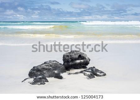 Volcanic pumice stones on the Tortuga Bay, Santa Cruz, Galapagos, Ecuador - stock photo