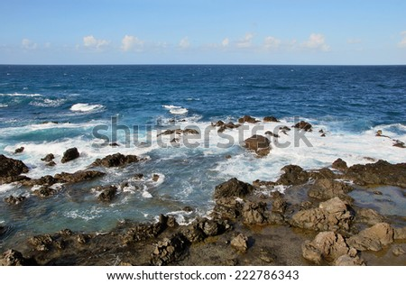 Volcanic rocks n the coast. Puerto de la cruz, Tenerife. Spain - stock photo
