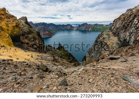 Volcanic rocky mountains and lake Tianchi, wild landscape, national park Changbaishan, China. - stock photo