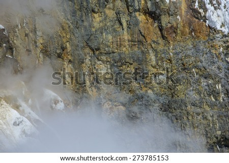 Volcano and Volcanic Rock With Steam Brown Texture - stock photo