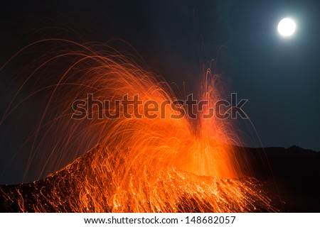 volcano Stromboli.  strong night eruption  at a full moon night - stock photo