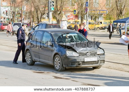 VOLGOGRAD - April 19: Not serious road traffic accident forces drivers to wait on site the police and insurance company representatives. April 19, 2016 in Volgograd, Russia. - stock photo