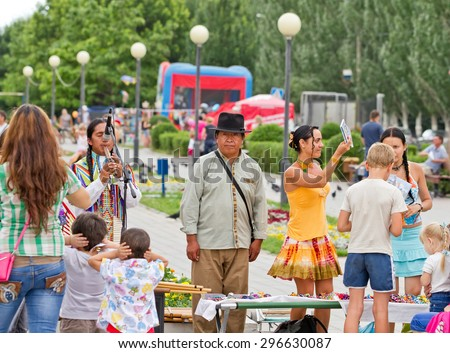 VOLGOGRAD - JUNE 20: Young students do not like ethnic music of South American Indians and they have closed their ears with hands. June 20, 2014 in Volgograd, Russia. - stock photo
