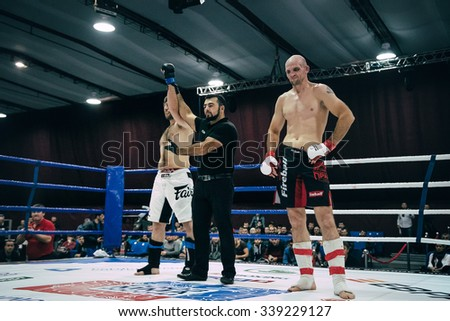 Volgograd, Russia - October 24, 2015: referee announces victory of MMA fighter during Championship of Russia on mixed martial arts - stock photo