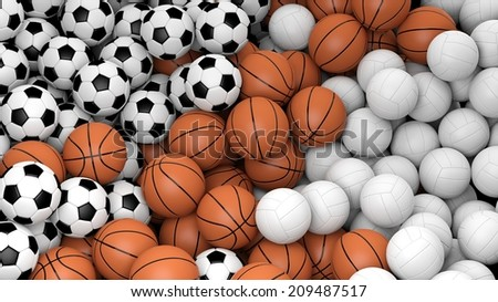 Volleyball, basketball and soccer balls piled  - stock photo