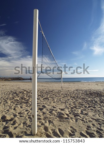 Volleyball net at a mediterranean beach. - stock photo