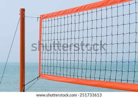 volleyball net at the beach against blue sky - stock photo