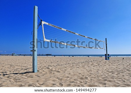 Volleyball net on a sand beach in summer - stock photo