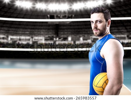 Volleyball player on blue uniform on volleyball court - stock photo
