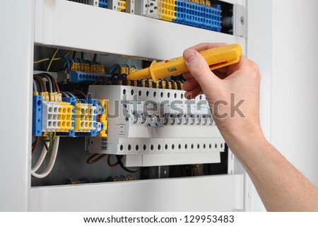 Voltage control in switchboard with special detector - stock photo