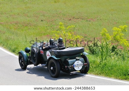 VOLTERRA (PI), ITALY - MAY 17: A green Bentley 4.5 Litre Le Mans takes part to the 1000 Miglia classic car race on May 17, 2014 near Volterra (PI). The car was built in 1929. - stock photo