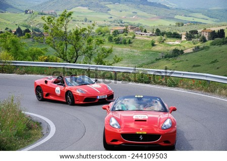 VOLTERRA (PI), ITALY - MAY 17: Two red Ferrari 430 Scuderia spider take part to the 1000 Miglia Ferrari Tribute on May 17, 2014 near Volterra (PI).  - stock photo