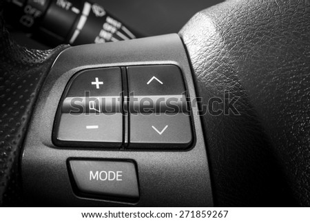 Volume and telephone command, Close up image of steering wheel of modern car. - stock photo