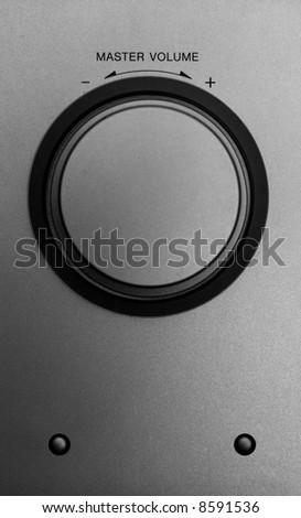 Volume control wheel on metal surface - stock photo