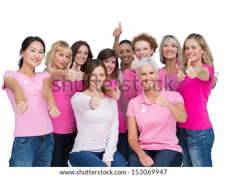 Voluntary women posing on white background and wearing pink for breast cancer - stock photo