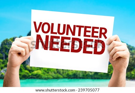 Volunteer Needed card with a beach on background - stock photo