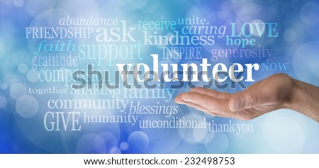 Volunteers needed hand gesture on blue bokeh  -  Male hand palm up with the word 'volunteer' floating above surrounded by relevant words on a blue bokeh background                                - stock photo