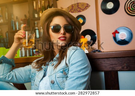 voluptuous young fashionable woman drink cocktail at bar. horizontal photo - stock photo