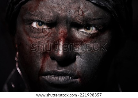 Voodoo with bloody black skin. Close-up portrait - stock photo