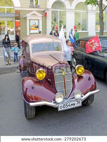 Voronezh, Russia - May 9, 2015: Soviet retro front-engine, rear-wheel-drive passenger car of 1930-40s sedan GAZ M1 (Emka) with fog-light - stock photo