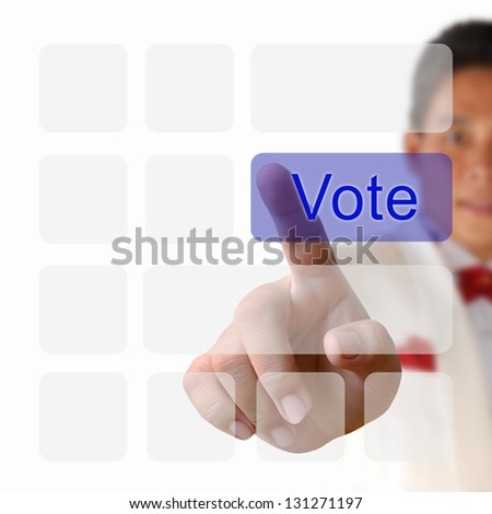 Vote button on keyboard with finger pushing a button - stock photo